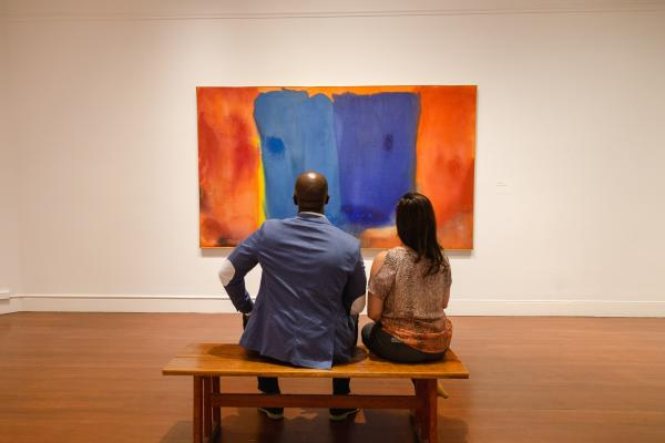 Couple sitting on a bench viewing art at the RISD Museum