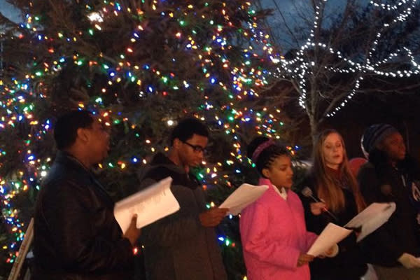 Olneyville Tree Christmas Carolers singing in front of Holiday Tree