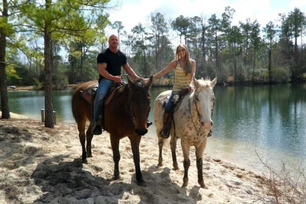 Couple Trail Riding at Splendor Farms