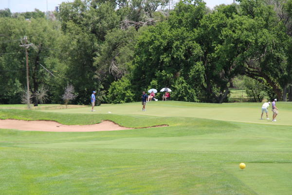 people playing golf at ross rogers gold complex wild horse course