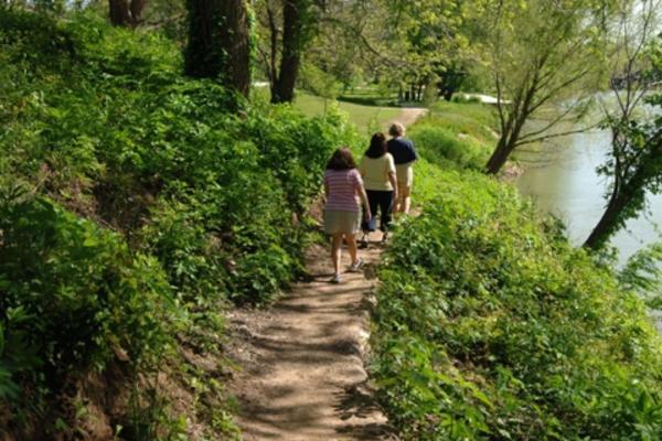 3 People Walking Down A Trail