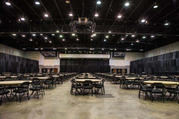 Empty Meeting Hall With Tables And Chairs And A Stage