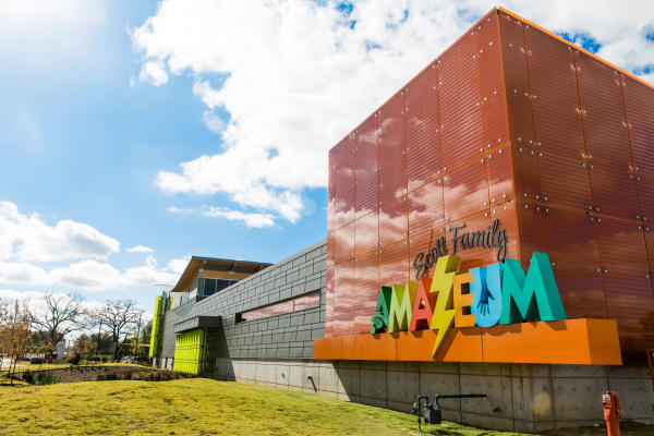 Image of the North East corner of the Scott Family Amazeum's exterior (the name of the museum is visibly shown)