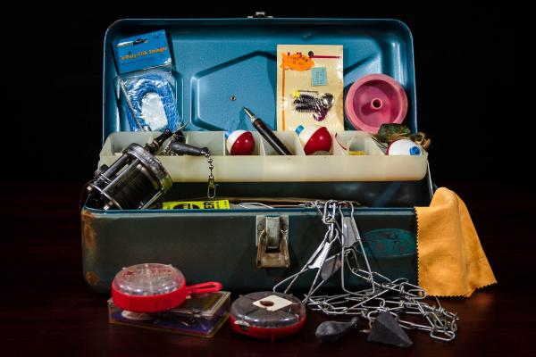 Fishing tackle box overflowing with necessities