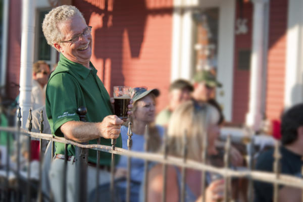 Man drinking Guinness on the patio of Brazenehad