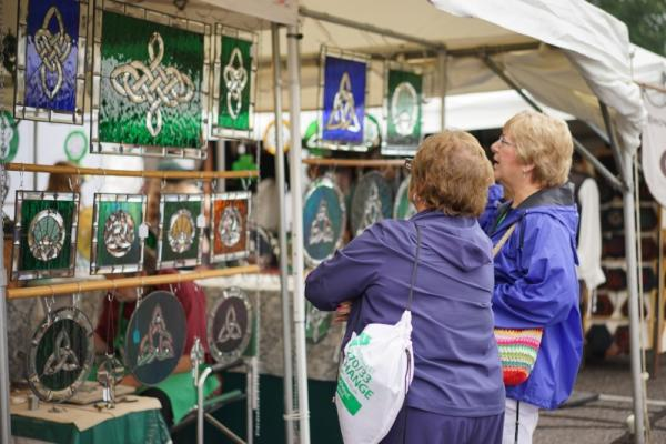 Women shopping Celtic knot stained glass at the Dublin Irish Festival
