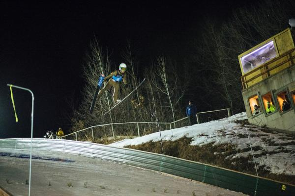 A person doing a ski jump at the Silver Mine Ski Invitational