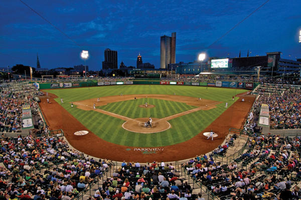 The TinCaps playing baseball in Parkview Field with the Fort Wayne, Indiana skyline in the background.
