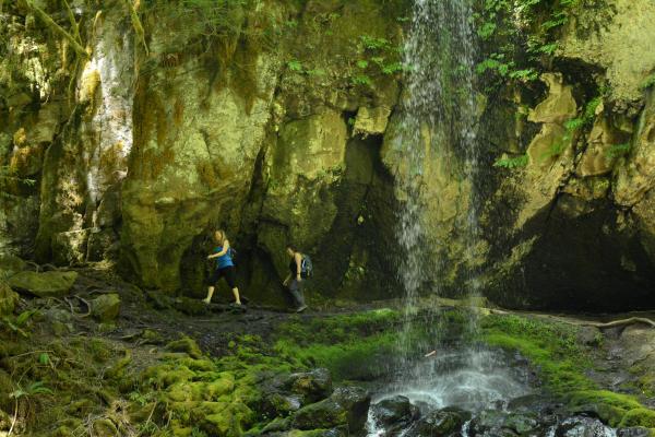 Hiking behind Upper Trestle Creek Falls by Colin Morton