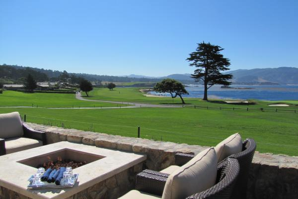 Outdoor seating at The Bench over looking Pebble Beach's golf course