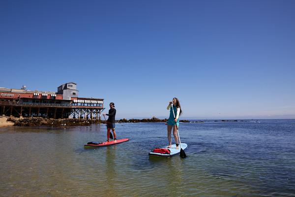 A couple Kayaking at Cannery Row in Monterey