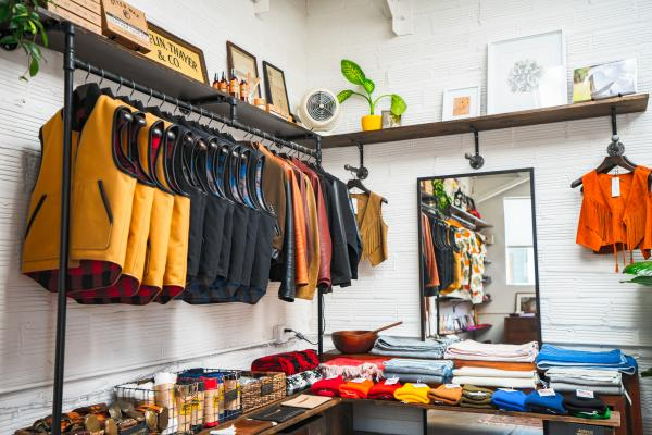 Clothing items including vests and jackets on display Inside Temescal Alley Shop of Oakland CA
