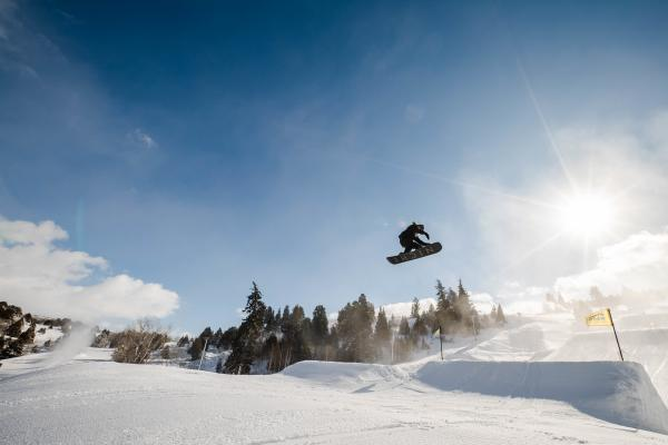 snowboarder going off a big jump