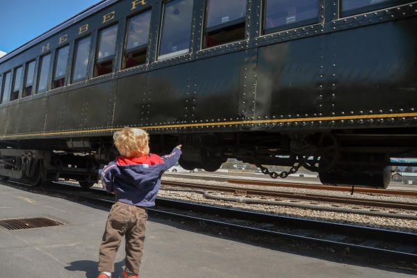 little boy pointing at train