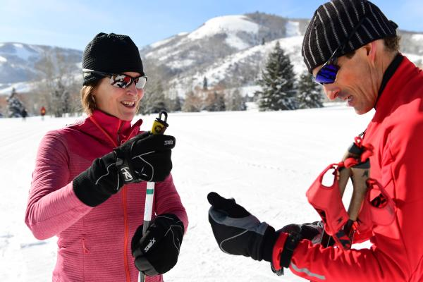 Coach and Student putting on winter gloves