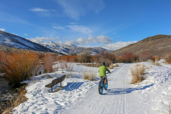 Person riding an Electric Fat Tire Bike on snow covered bike path