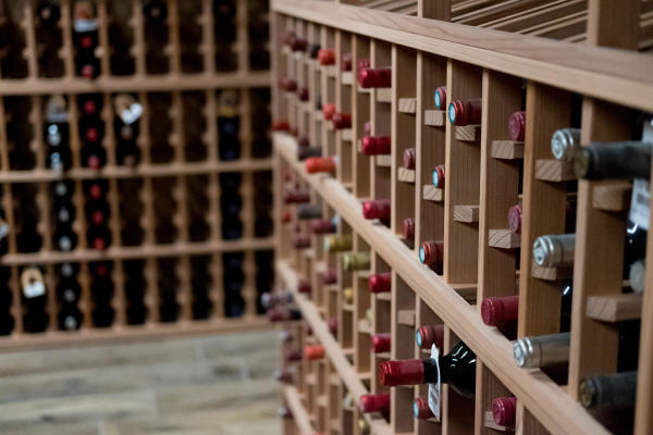 a large amount of wine bottles stored in wine racks