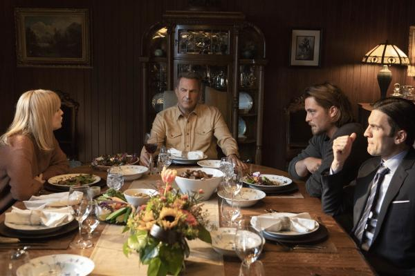 Actors from TV show Yellowstone sitting at dinner table