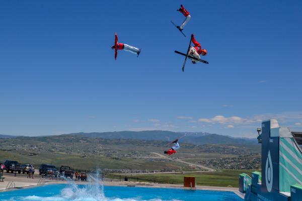 Freestyle Skiers Jumping into pool at Utah Olympic Park