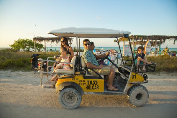 Family on Golf Cart Taxi