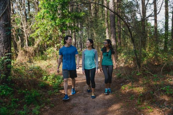 Three friends hiking on one of the trails at Cullinan Park.