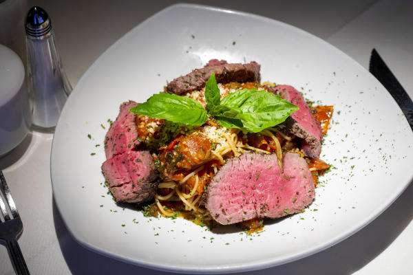 Steak with pasta at Perry's Steakhouse & Grille