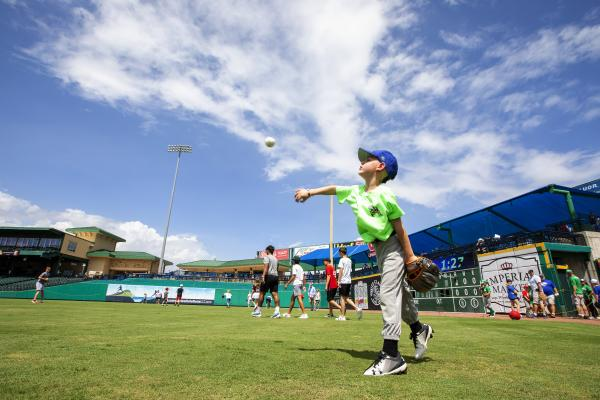 Child tossing baseball at Constellation Field in Sugar Land, Texas