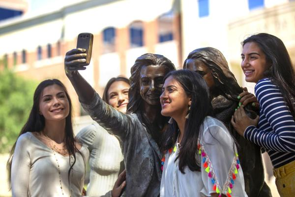Girls posing with Selfie Statue at Sugar Land Town Square