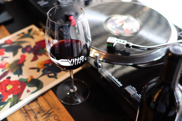 Glass of wine at a turntable
