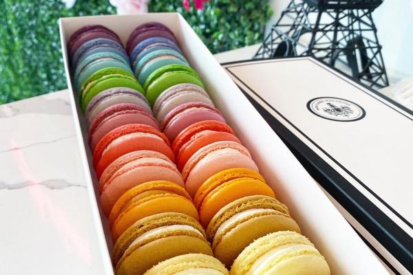 A selection of rainbow colored macarons.