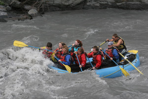 People in a river raft on a river in Keystone Canyon