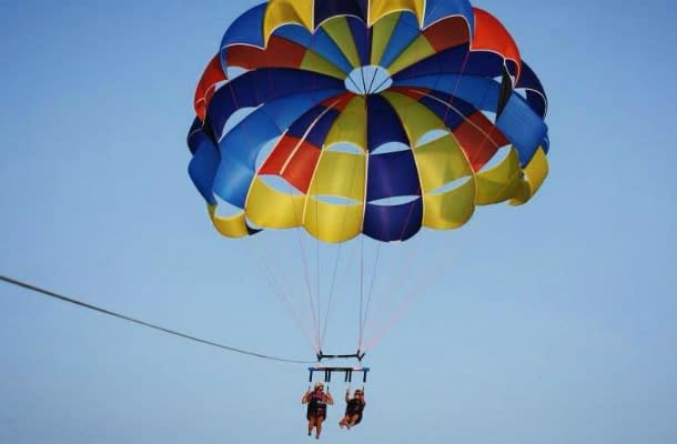 Couple parasailing in Grand Bend