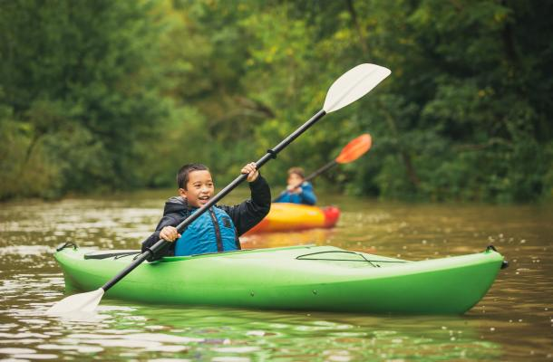 Boys paddling big creek