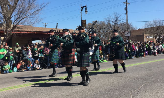 Five men march through Delano in Wichita and play bagpipes for the St. Patrick's Day Parade