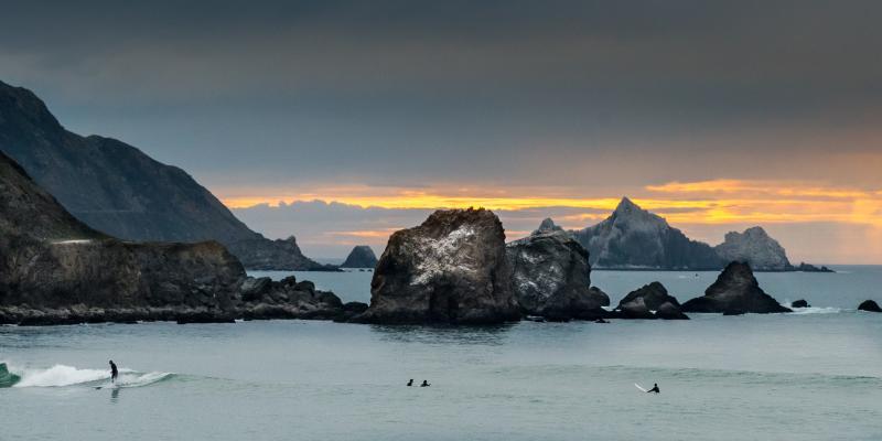 Surfers at dusk at Rockaway Beach in Pacifica California