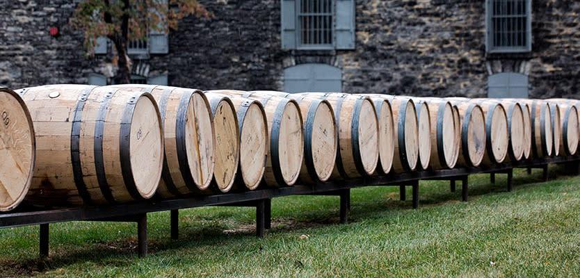 Line of bourbon barrels on a track