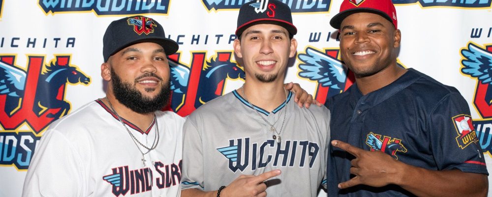 Three players for the new Wichita Wind Surge baseball team pose for the camera in uniform