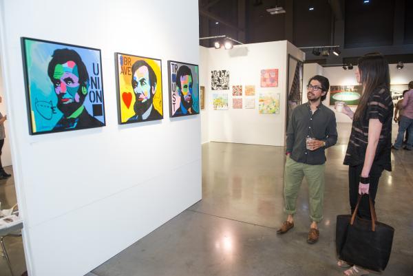 People viewing artwork at  Art Alliance Austins annual Art City Austin festival