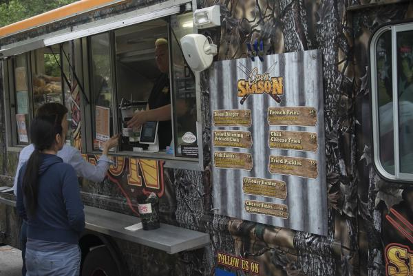 Couple orders food at PVDfest Food Village food truck