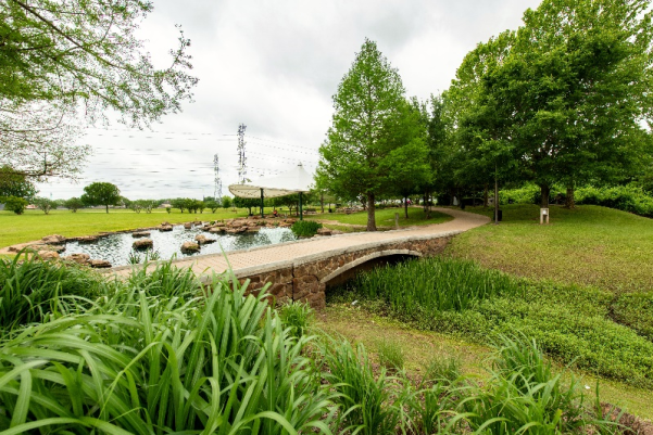 Walking trail in front of fountains at Oyster Creek Park