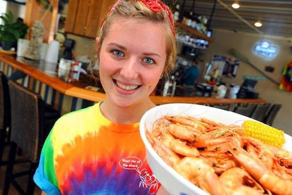 Crabby Shack waitress with shrimp