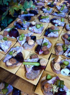 Wooden charcuterie plates at Taste of Dine Originals