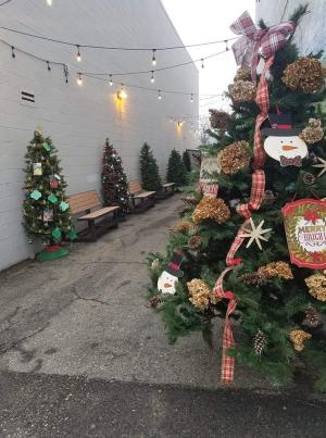Decorated Christmas trees are displayed in an alleyway at Manchester Christmas in the Village
