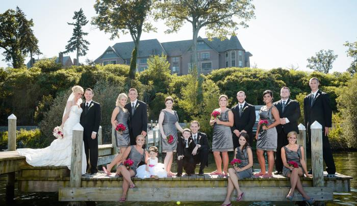 Photo of a wedding party outside on a dock at Belhurst Castle