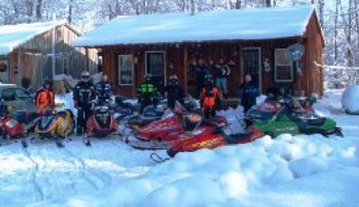 Snowmobilers at Cabin