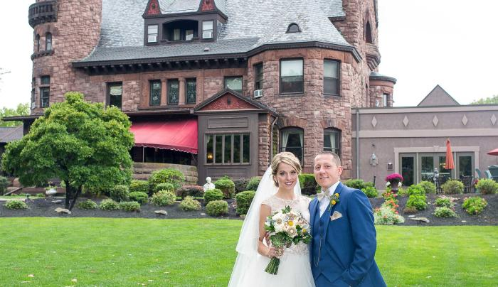 Photo of a bride and groom at an outdoor wedding at Belhurst Castle