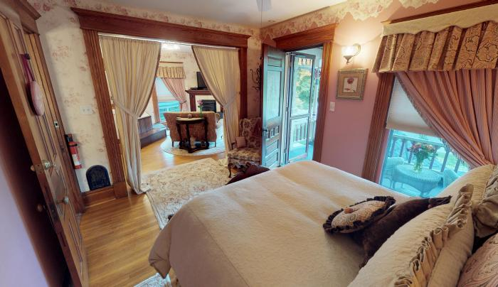 Relax in our 2-room Suite with double jetted tub, large fireplace/TV and private porch!