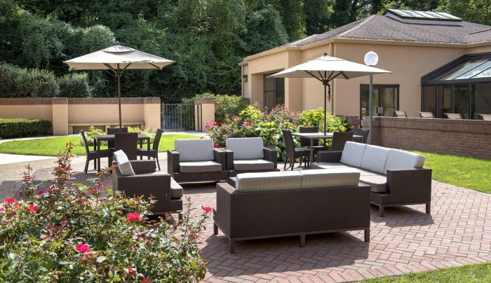 Landscaped outdoor patio lounge, open seasonally