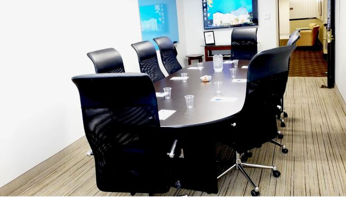 Newly renovated conference room sits up to 8 people