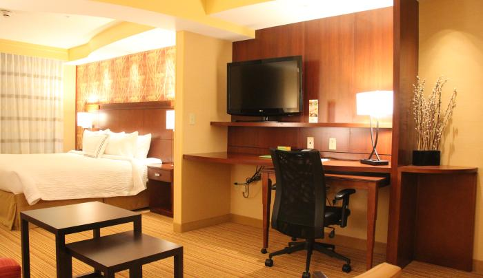 Lit Room with Desk Area